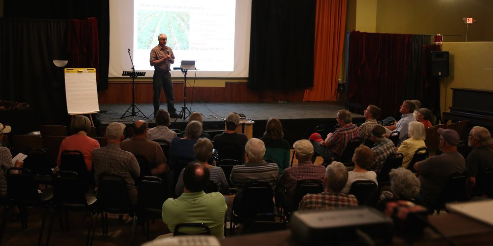Shawn Schottler, St Croix Watershed Research Station, speaking at the WideSpot Performing Arts Center in Stockholm, Wisconsin