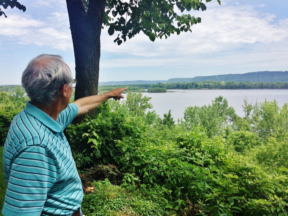 Bruce Ause points to sediment build up in Lake Pepin