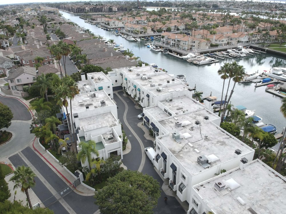 Luxury home for lease in Spinnaker Bay in Long Beach. 3 bedrooms, 2 1/2 bathrooms, huge master suite, and a rooftop deck - located steps from the water.  Offered for LEASE $4,495 month