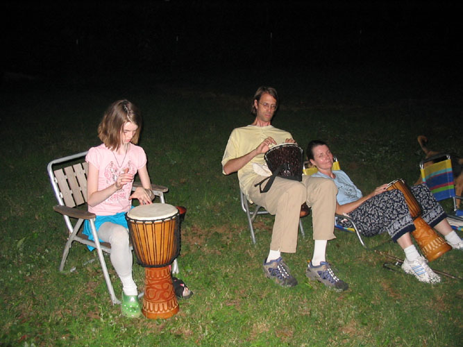 Anna Lloyd, David and Elisa Carlson, at an evening drumming