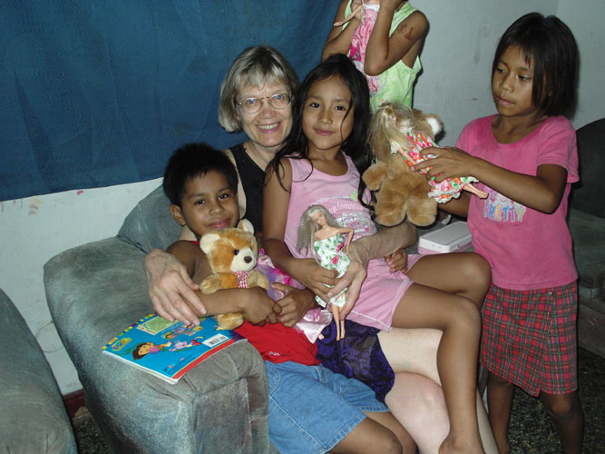 Dr. Linda Westman of Atlanta, Georgia, with children in Iquitos, Peru