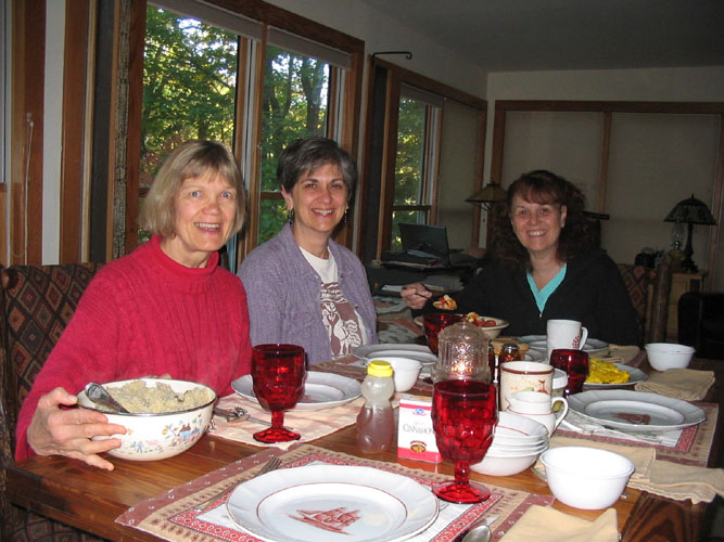Linda Westman, Cheryl Lossie, and Debbie Winter getting ready for the feast