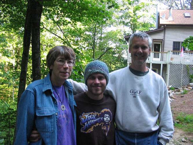 Jean Logan, Sunova, and Will Morar with Holy Ground Farm Headquarters in the background