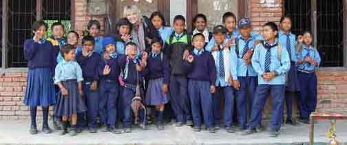 This is Cathy with the children in front of the Happiness Orphanage. The children are in their school uniforms. All are doing well in school.
