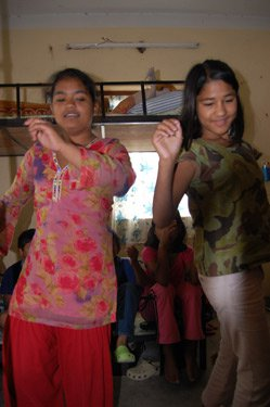 Children at the orphanage dancing.