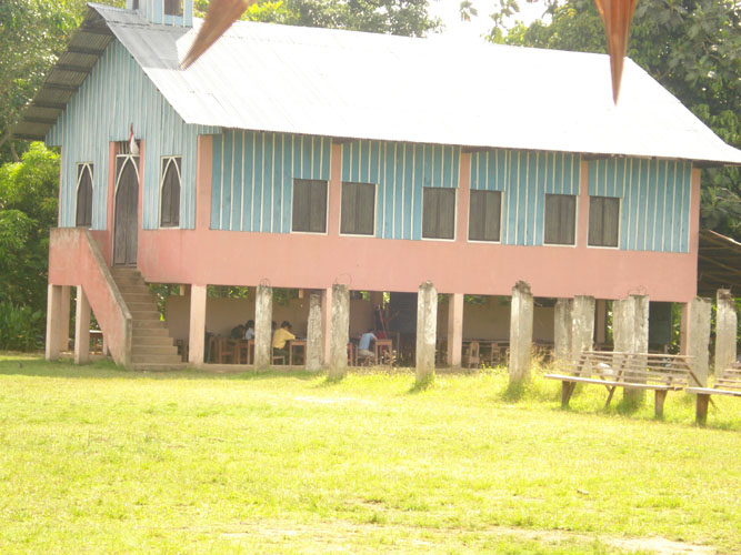Community church building with open class rooms under building.