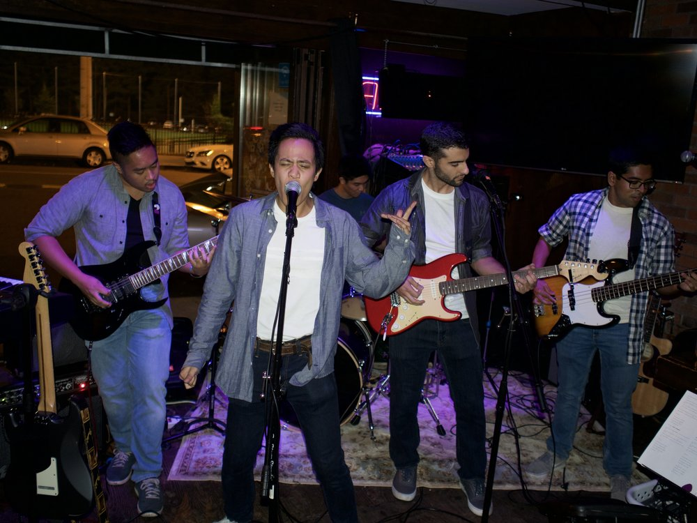 Arts and Medicine co-president Jet Navia rocks out along side Tad Umali, Frank Migliarese, and Saumik Rahman.