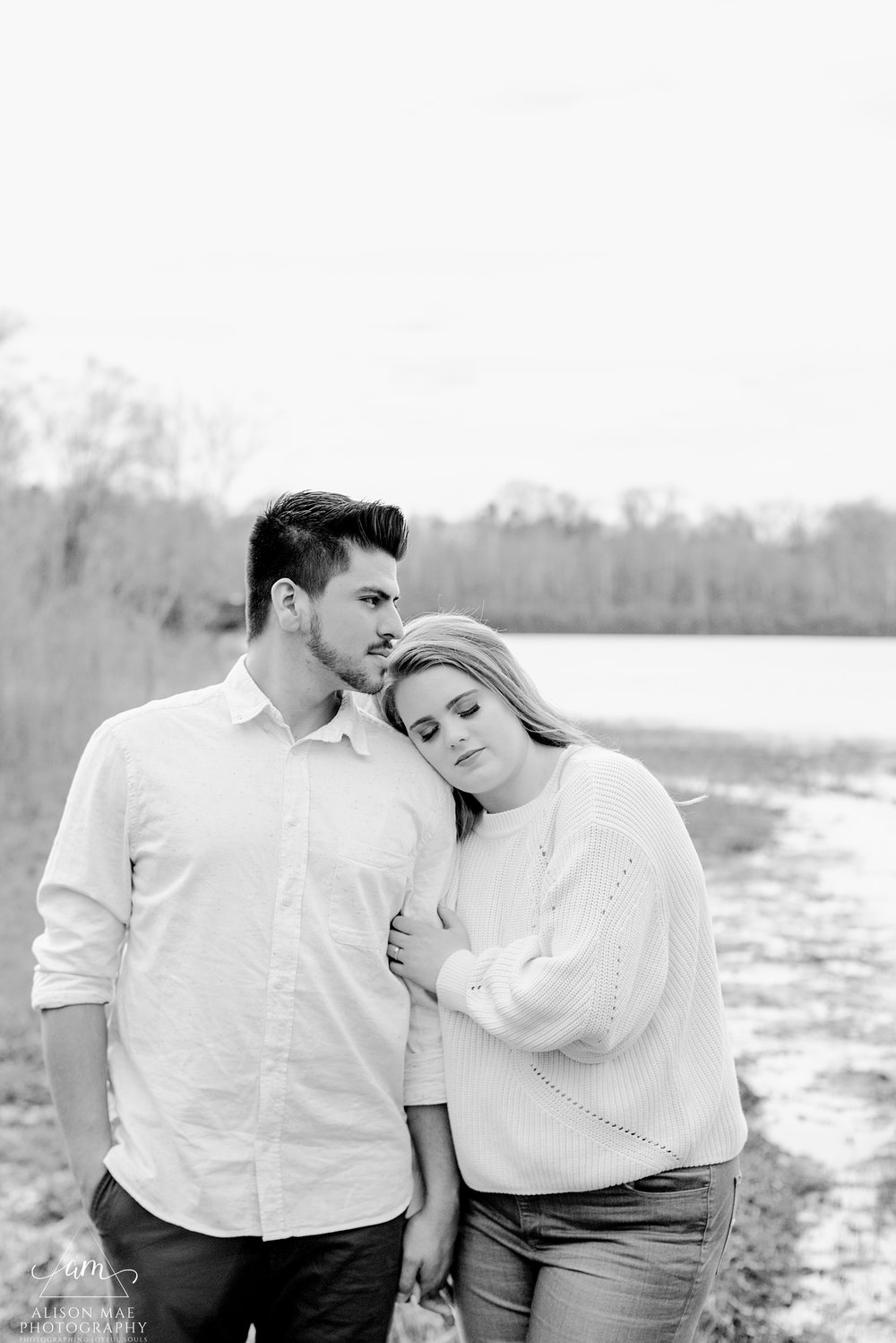 Young couple standing peacefully by pond at 100 Acre in Indianapolis