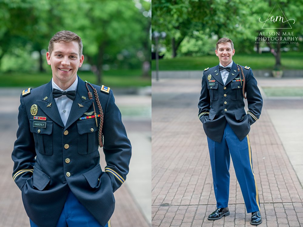 Groom poses for portraits in downtown Fort Wayne on his wedding day