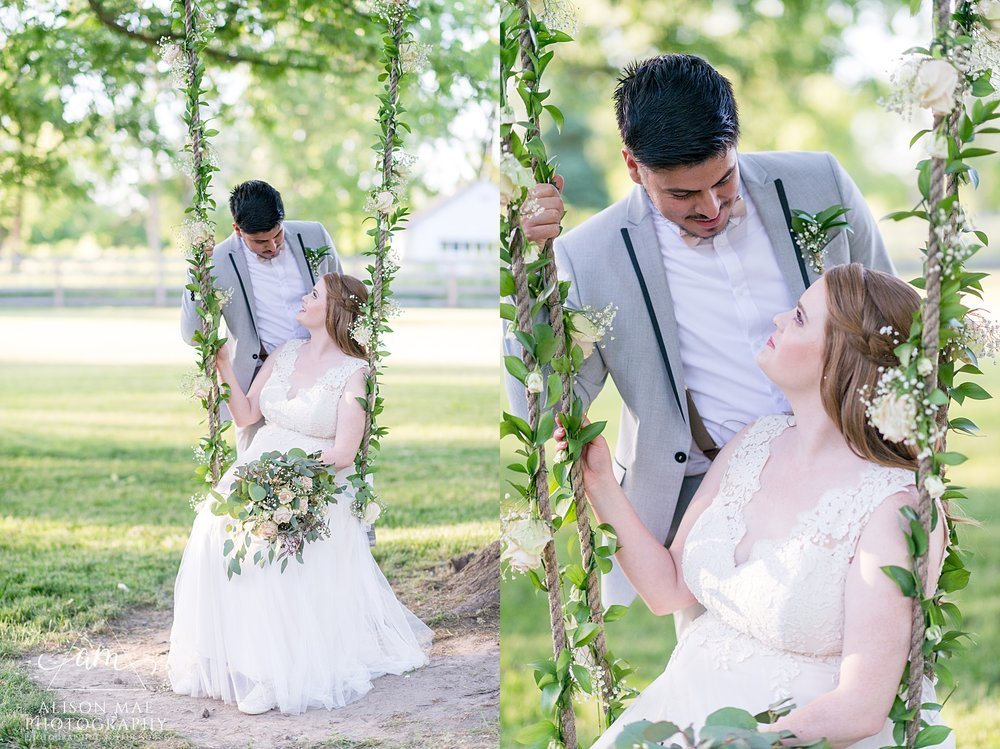 Bride and groom pose on swing on their wedding day - taken by Indiana wedding photographer - Alison Mae Photography