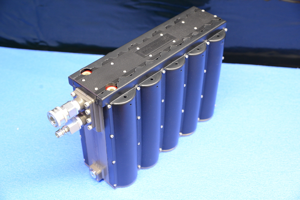 Liquid cooled, anodized package for large format Li-ion cells