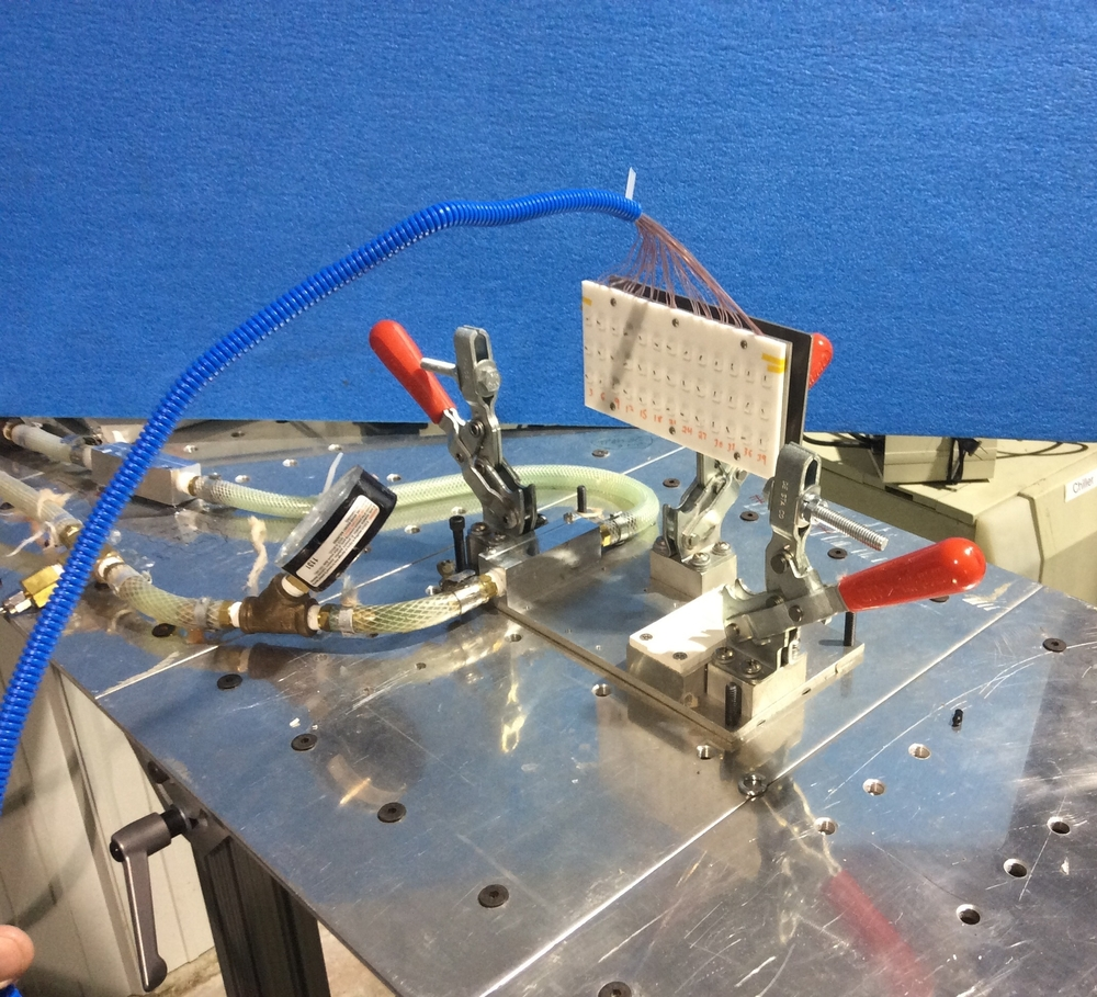 Custom thermal test bed with embedded thermocouples and chip simulators
