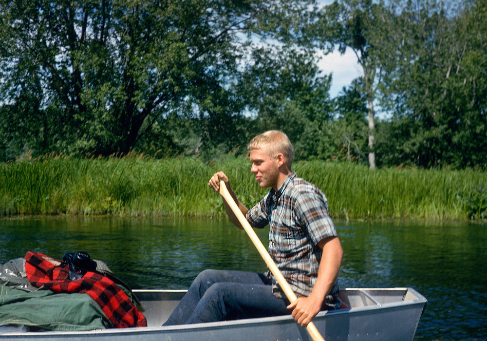 Phil at age16 paddling down the Penobscot River with his Nikkormat, scanned on a drum scanner from a Kodachrome slide