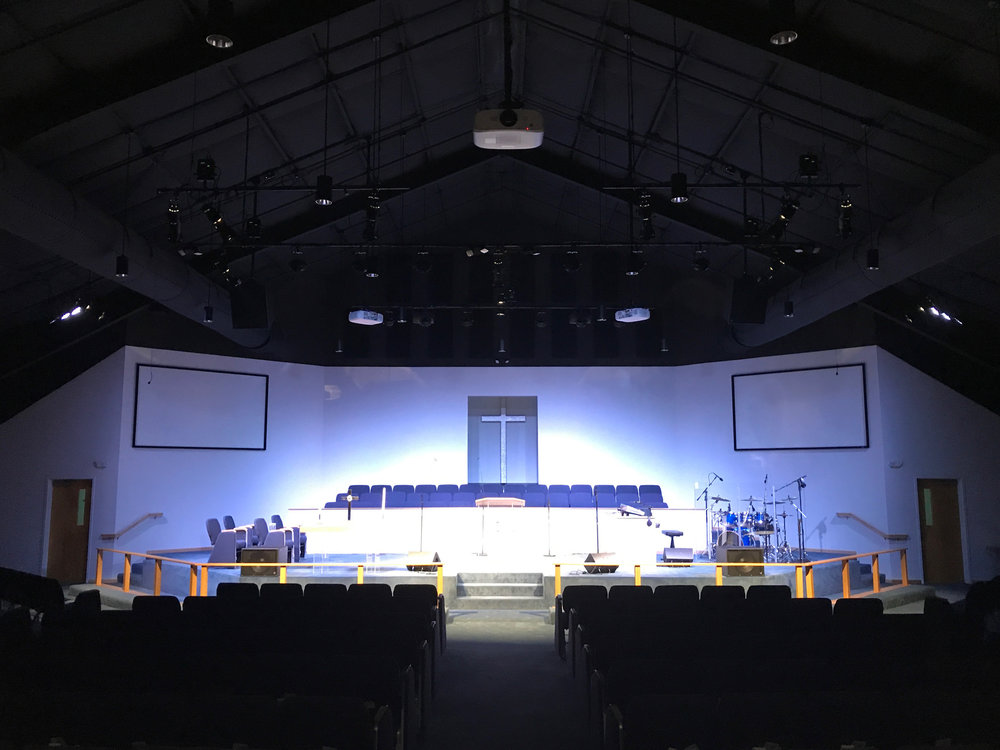 From the ceiling hangs Worx Audio X3 line arrays along with X115 sub-woofers, which gives the room excellent audio clarity and coverage. Three HD video projectors, give the stage and rear screen high quality video.