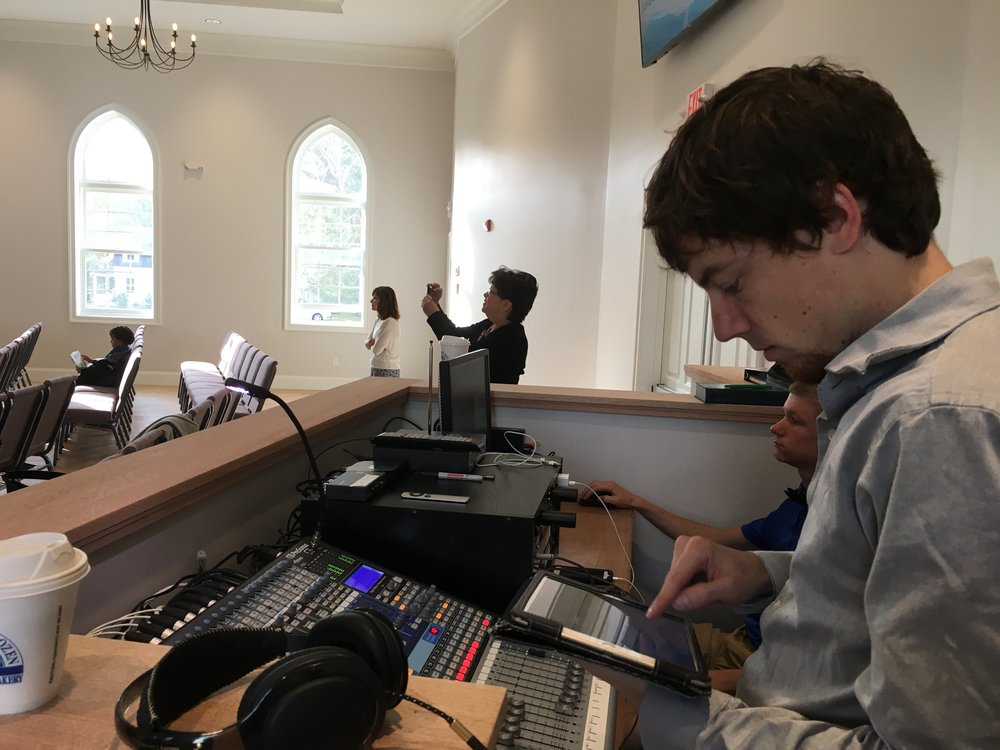 Josh setting up the Presonus digital console with the iPad app, Atlona video distribution system for the main and rear LCD screens, as well as the downstairs and fellowship hall.