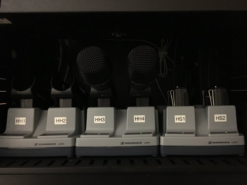 Sennheiser wireless microphiones with antenna distibution and recharging station.