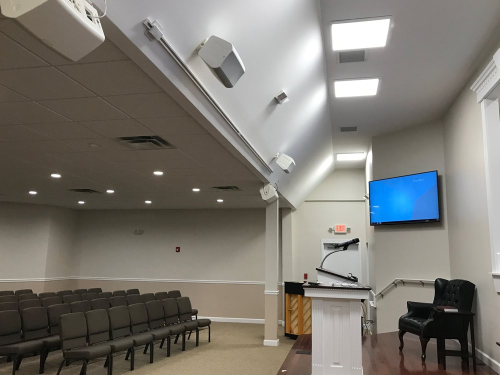 Stage area included floor pockets and ceiling mounted stage monitors per request of the client. .