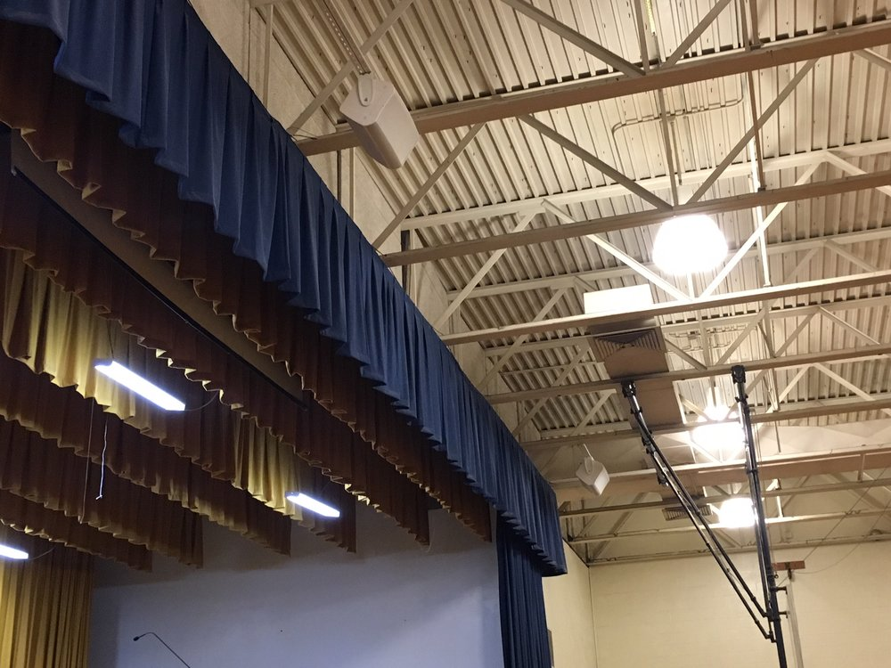 QSC AD-S12 main speakers (3 installed) for clear audio. Choir microphones were provided along with additional stage inputs..