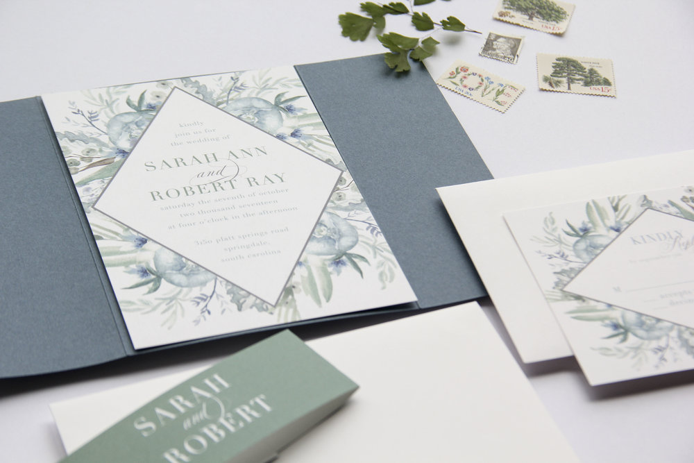 French blue wedding invitations. Dusty blue wedding invitations. Bespoke Stationery. Slate blue wedding invitations. Custom wedding invitations. Gate folds. Belly band. Calligraphy wedding invitations. Greenery wedding invitations by Unica Forma based out of Columbus Ohio