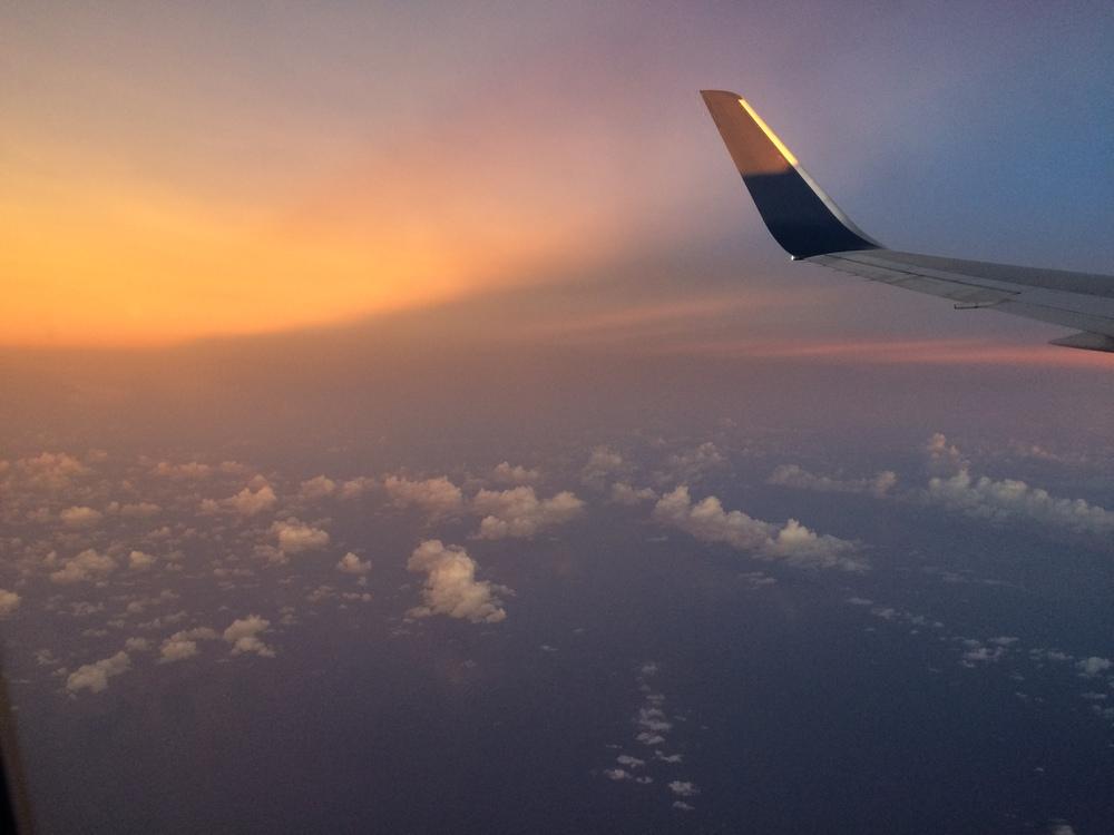 Sun setting over South China Sea to Bangkok from Tokyo
