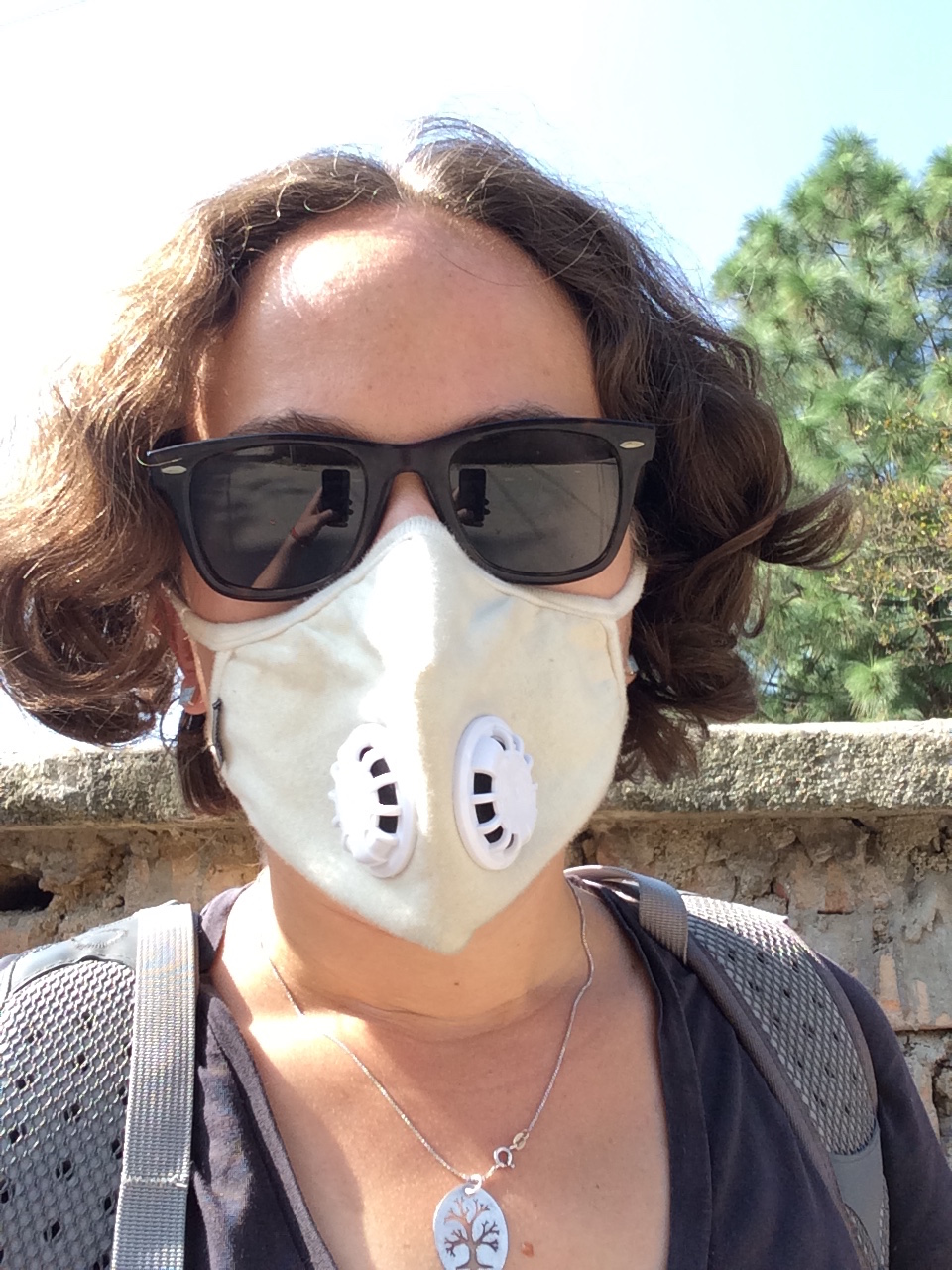 A selfie in my freshly-washed trusty VogMask and dust-protecting sunglasses