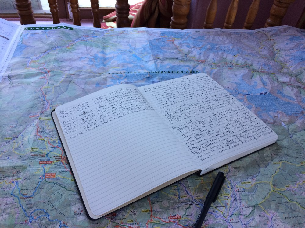 Nightly ritual of calculating mileage and elevation gain on my map using a piece of floss to follow trail contours