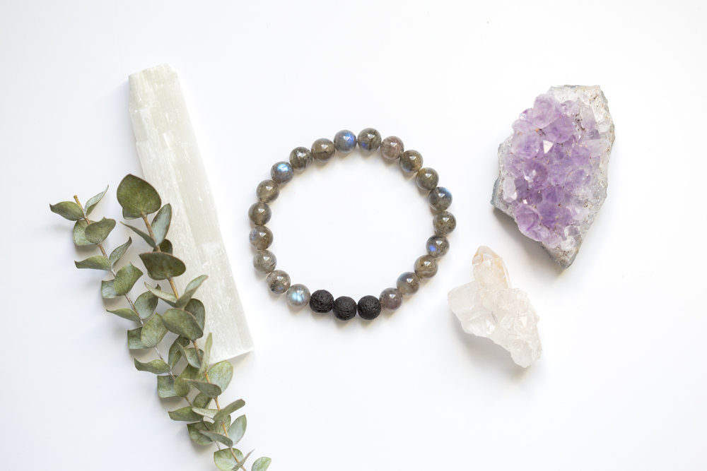 Metaphysical bracelets made of crystals and lava stones for essential oil diffusers created by Wander Knot.