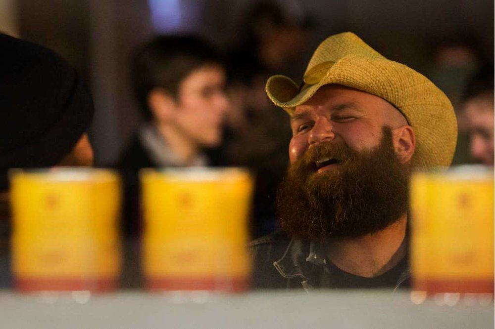 Competitor Josh Dand, right, laughs with a friend at the kickoff of the fifth annual Beard and Stache Fest on Sunday, Feb. 24, 2013, at Hilliard's Beer in Seattle, Wash. Although the event raised over 17,000 dollars last year, Dand is determined to have this year's net over 25,000 dollars. The night's events kicked off a month-long competition featuring over 100 furry-faced men. All donations benefited foster children in King County.   Photo: JORDAN STEAD