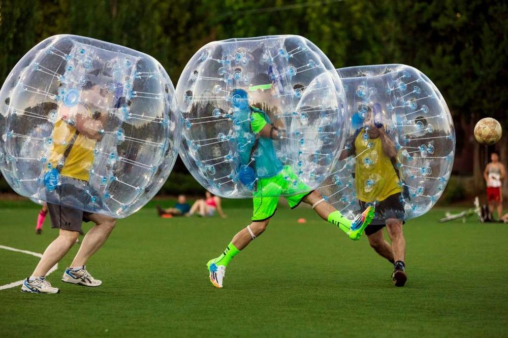 "Players push downfield, often to collide, while encased in bouncy, blue orbs as part of Seattle's first ""Bubble Futbol"" - or soccer - tournament Sunday, September 7, 2014, at Cal Anderson Park in Capitol Hill in Seattle, Washington. The unlikely sport originated in Europe and is quickly sweeping the U.S., with a recent spotlight on The Tonight Show with Jimmy Fallon. The event was put on by Seattle-local nonprofit ""The World is Fun"" as a celebration of the organization's fifth anniversary.   Photo: JORDAN STEAD, SEATTLEPI.COM"