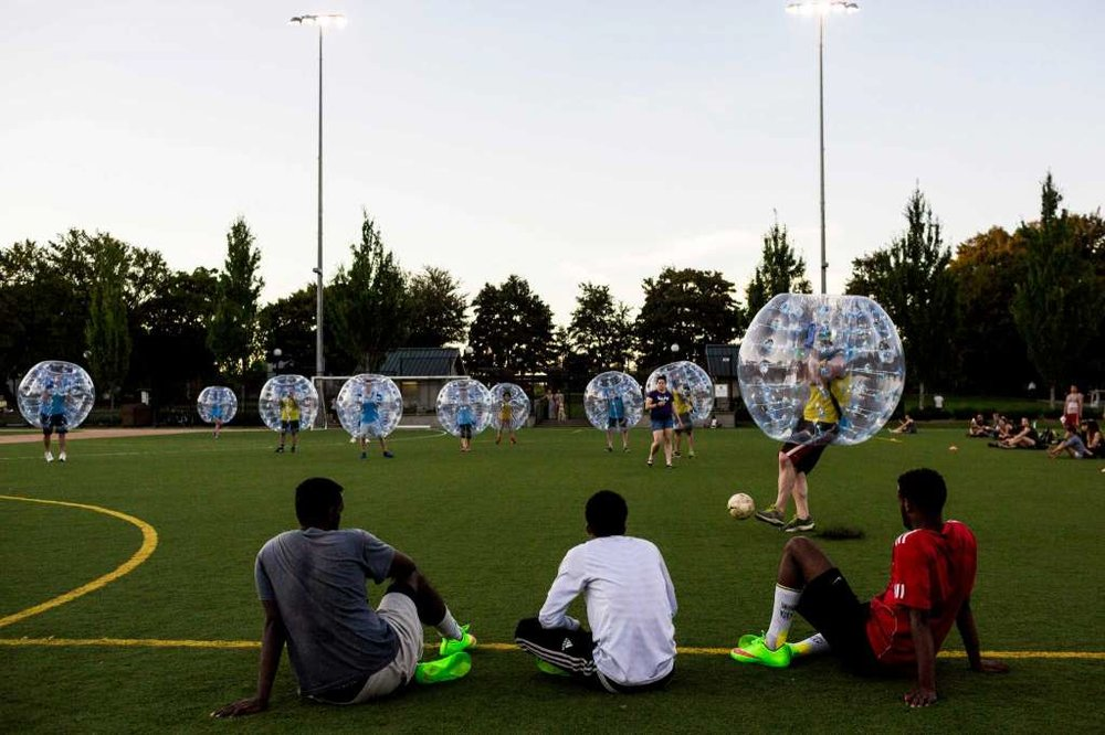 "Encased in bouncy, blue orbs, participants took part in Seattle's first ""Bubble Futbol"" - or soccer - tournament Sunday, September 7, 2014, at Cal Anderson Park in Capitol Hill in Seattle, Washington. The unlikely sport originated in Europe and is quickly sweeping the U.S., with a recent spotlight on The Tonight Show with Jimmy Fallon. The event was put on by Seattle-local nonprofit ""The World is Fun"" as a celebration of the organization's fifth anniversary.   Photo: JORDAN STEAD, SEATTLEPI.COM"