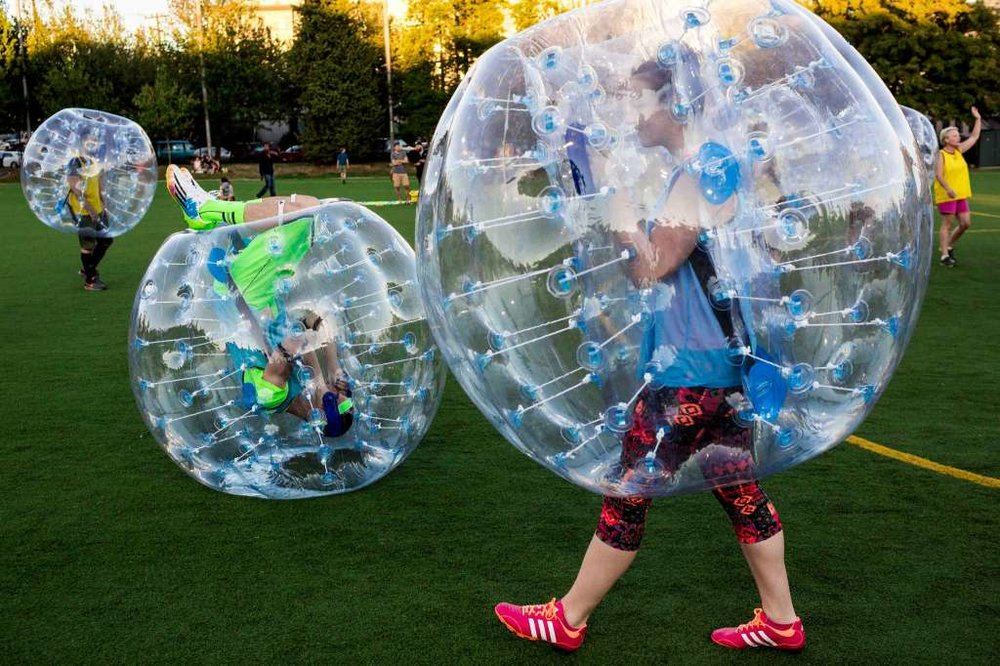"Before the first match, players tested out the ""crash-ability"" of their bouncy, blue orbs during Seattle's first ""Bubble Futbol"" - or soccer - tournament Sunday, September 7, 2014, at Cal Anderson Park in Capitol Hill in Seattle, Washington. The unlikely sport originated in Europe and is quickly sweeping the U.S., with a recent spotlight on The Tonight Show with Jimmy Fallon. The event was put on by Seattle-local nonprofit ""The World is Fun"" as a celebration of the organization's fifth anniversary.   Photo: JORDAN STEAD, SEATTLEPI.COM"