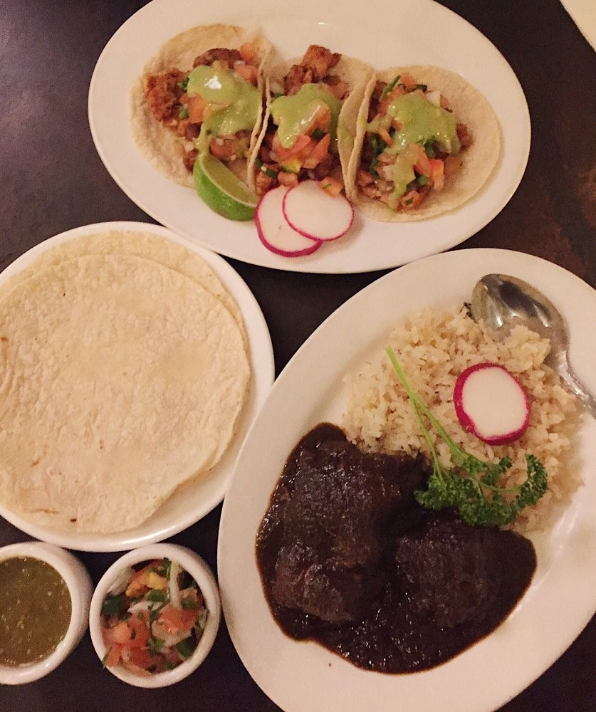 try the dishes at like Mezcaleria Oaxaca .   Photo courtesy of Yelp