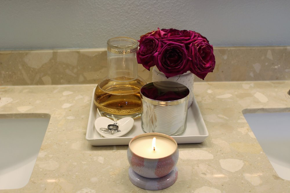 A vase for pretty roses and a Q-tip and cotton pad holder for our bathroom.  Love!