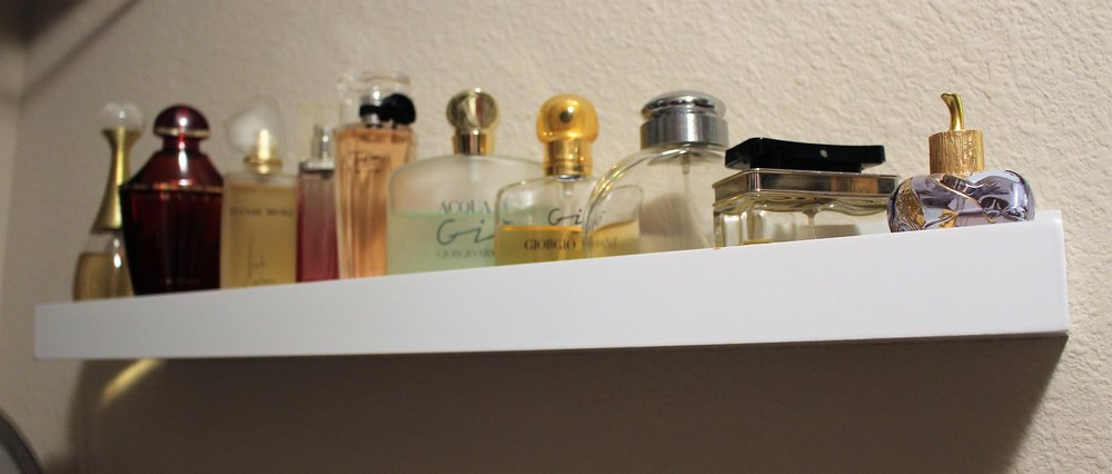 I found that picture ledges help keep perfume bottles nicely and out of the way.