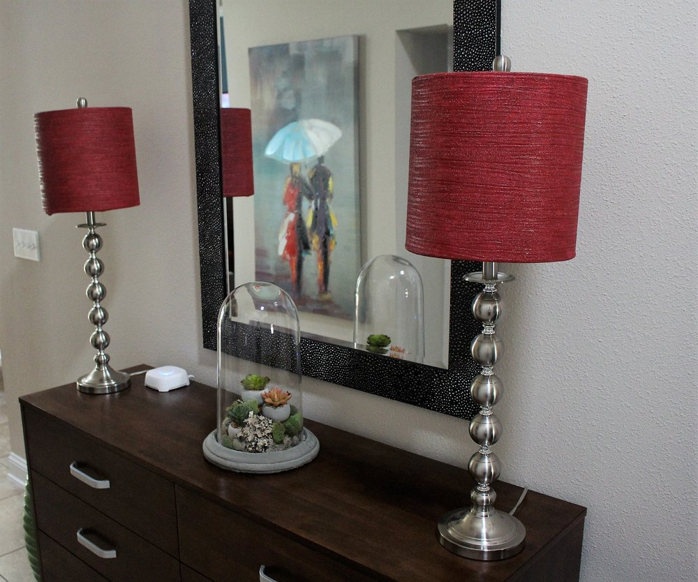 Instead of replacing these lamp shades to match out decor, I simply painted them red to match!