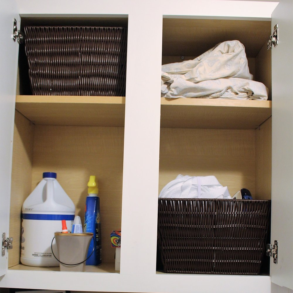 using baskets to organize laundry room