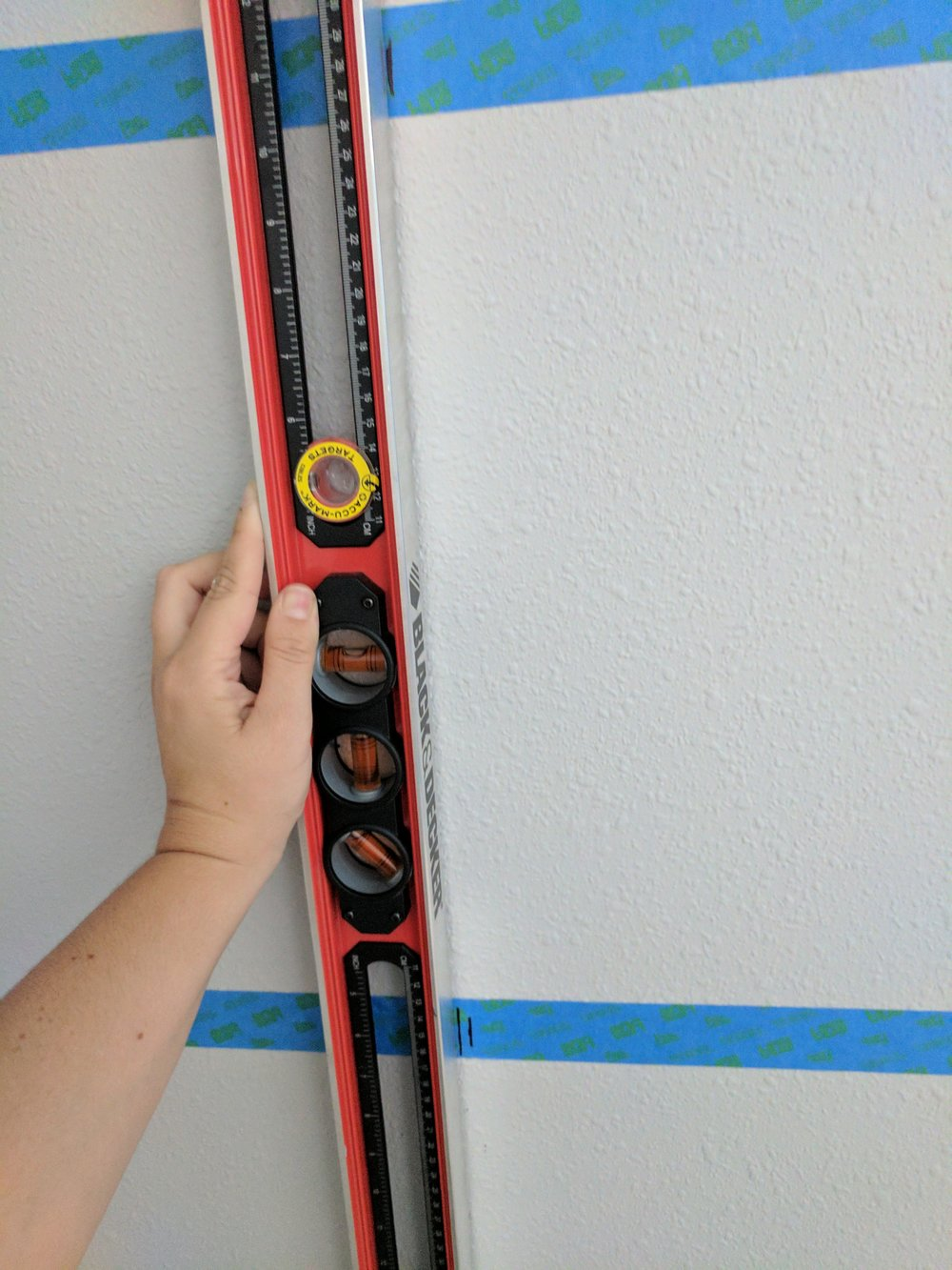 When hanging more than one shelf, remember to not only level the tape but also the hole marks on multiple shelves. This ensure your brackets like up with the shelf above and below it.