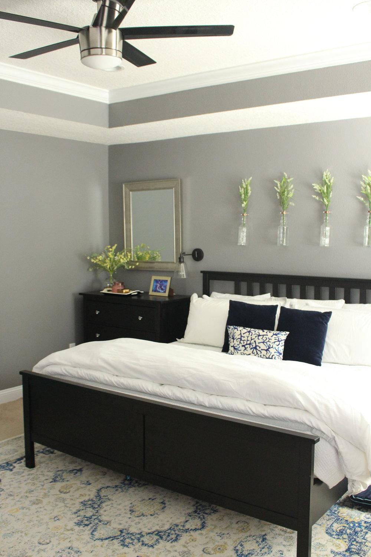 A moody gray helps create a cozy master bedroom retreat.