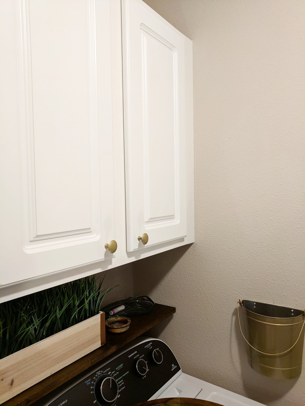 adding hardware to cabinets