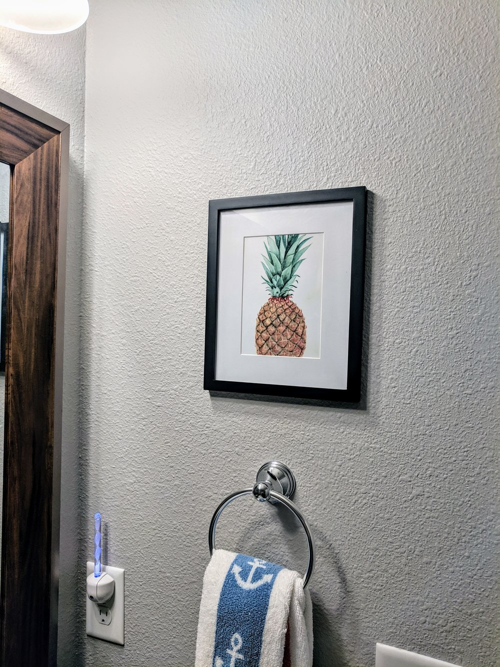 Pineapple print bathroom decor.