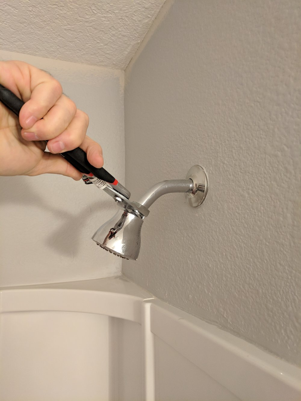 Remove old shower head.