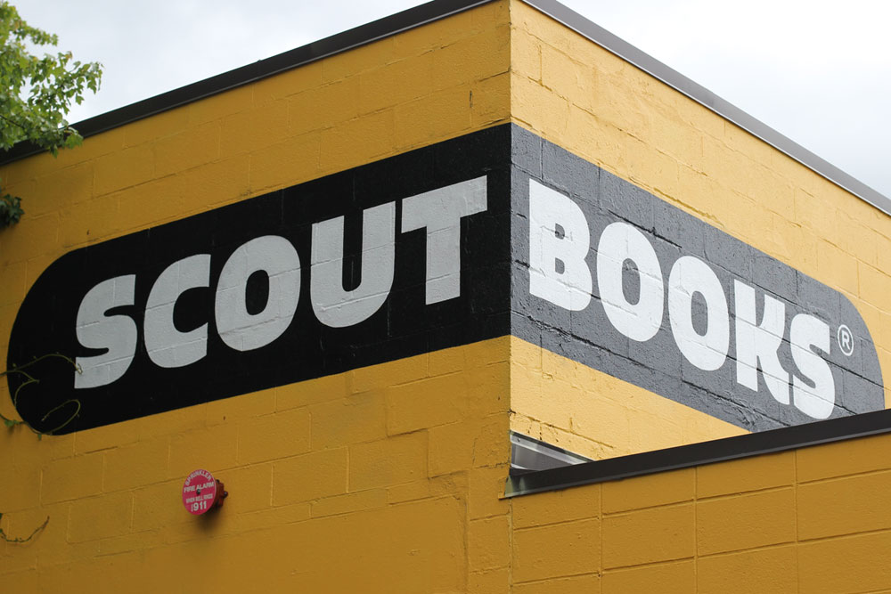 Scout Books logo set in Quatro Ultra Black - Image from  Astoria Signs