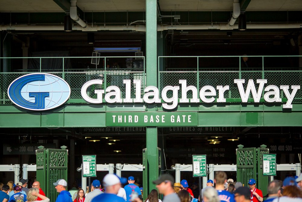 Gallagher sponsors the third base gate at Wrigley Field in Chicago and transformed the typeface/logotype into large neon sign for the section Image Courtesy of Brand 33
