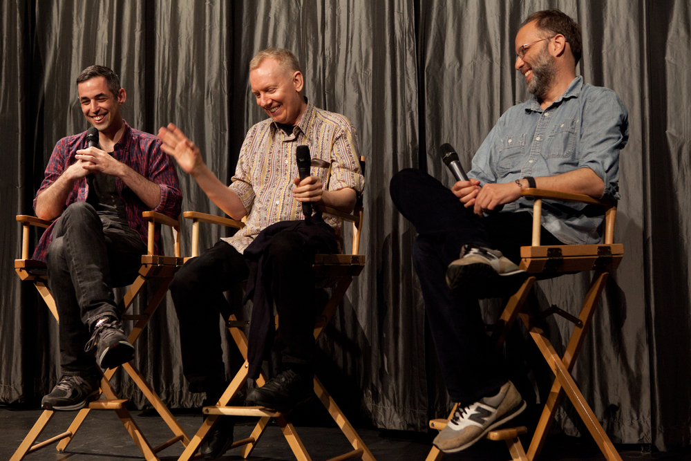 Queer|Art|Film co-curators Adam Baran and Ira Sachs on stage with presenter John Epperson at the May 2014 screening of  OUTRAGEOUS! . (Photo by Ryan Morris)