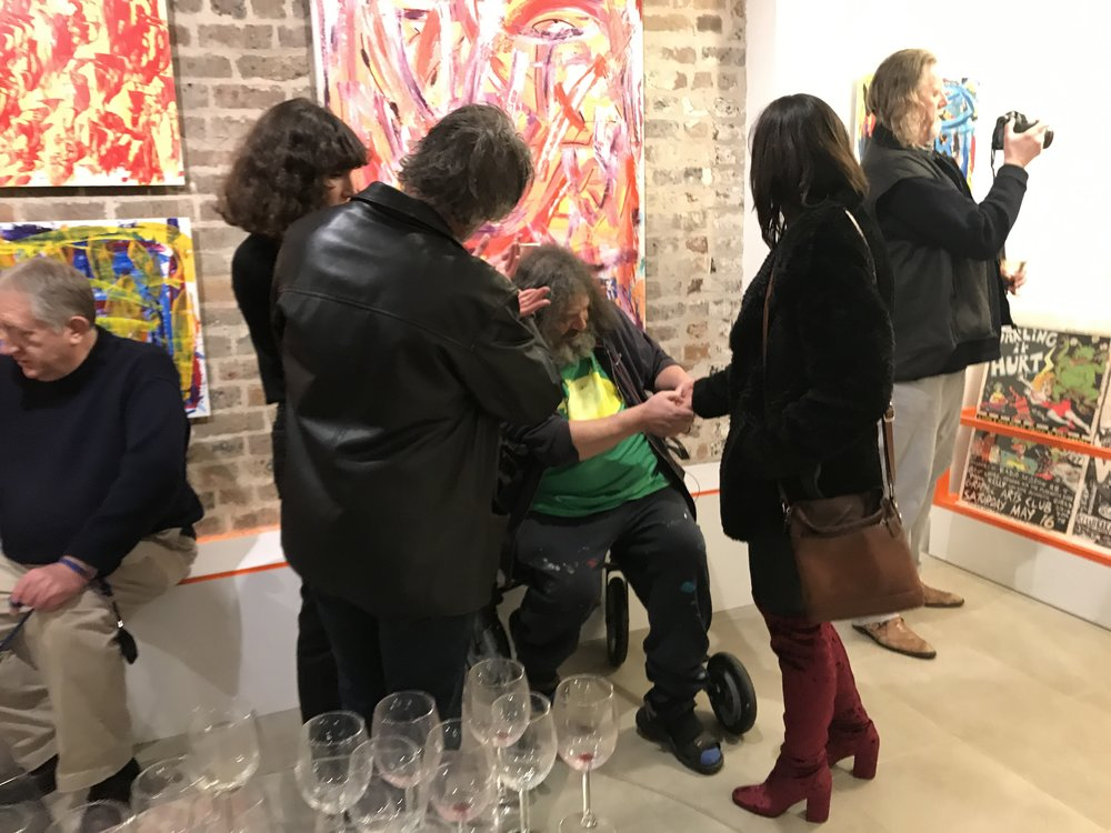 Michael Saker palm reading on opening night of 'The Work of Michael Saker' at Disorder Gallery