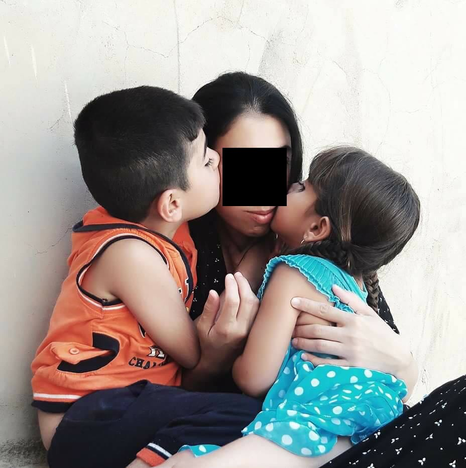 One of the thousands of surviving ladies who was captured and abused by ISIS, with her two remaining children. For the their safety, we are not able to show their faces. This is one of dozens that our team is helping.