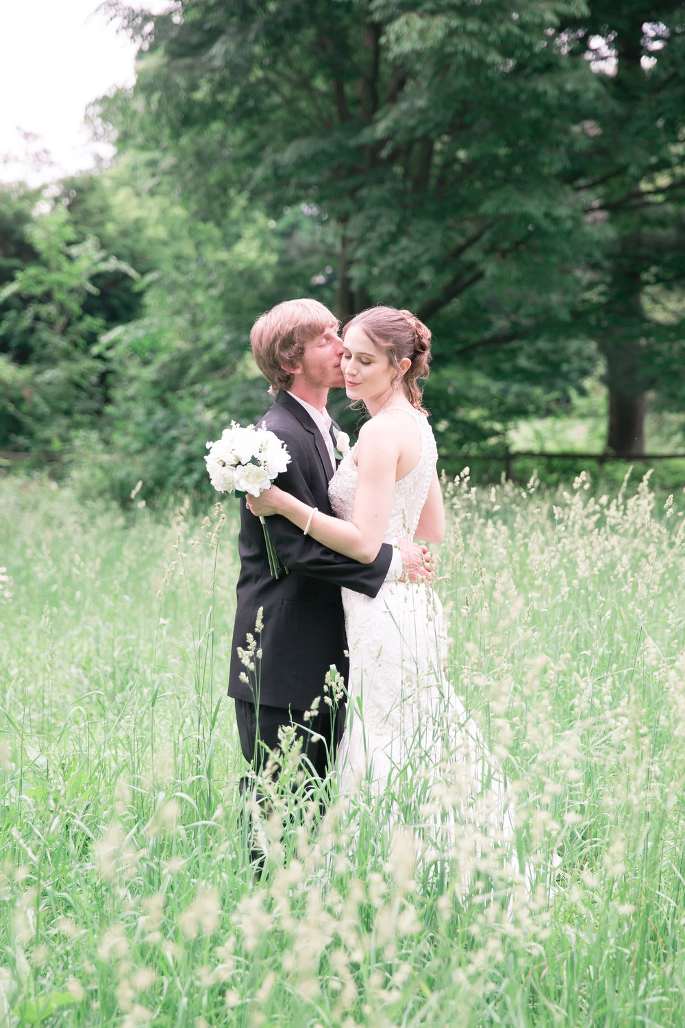 Could a picture get any sweeter?  I love that my couples are ok going into some high grass or funky spots for some amazing pics!