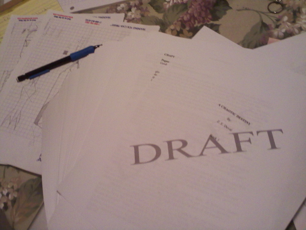 "The first printed draft of ""A Chaotic Destiny"" circa Jan 2013. Note terrified graph paper in the background."