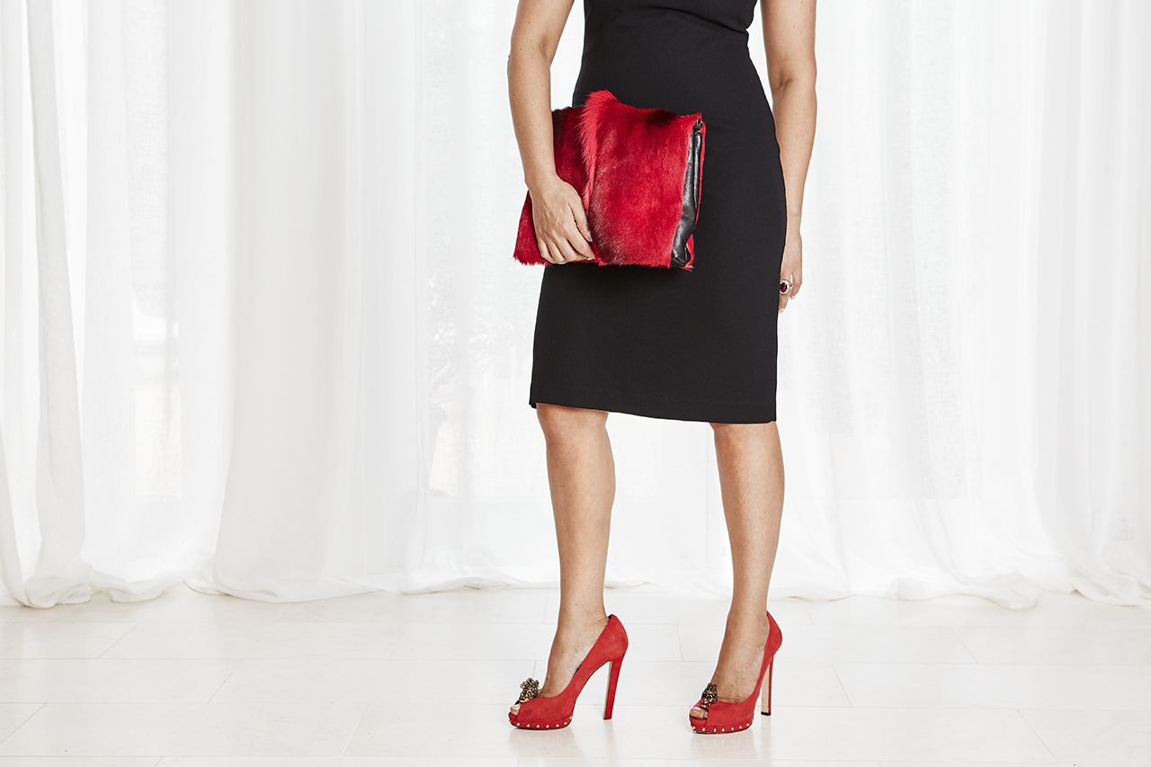 Dries Van Noten clutch and red Alexander McQueen pumps