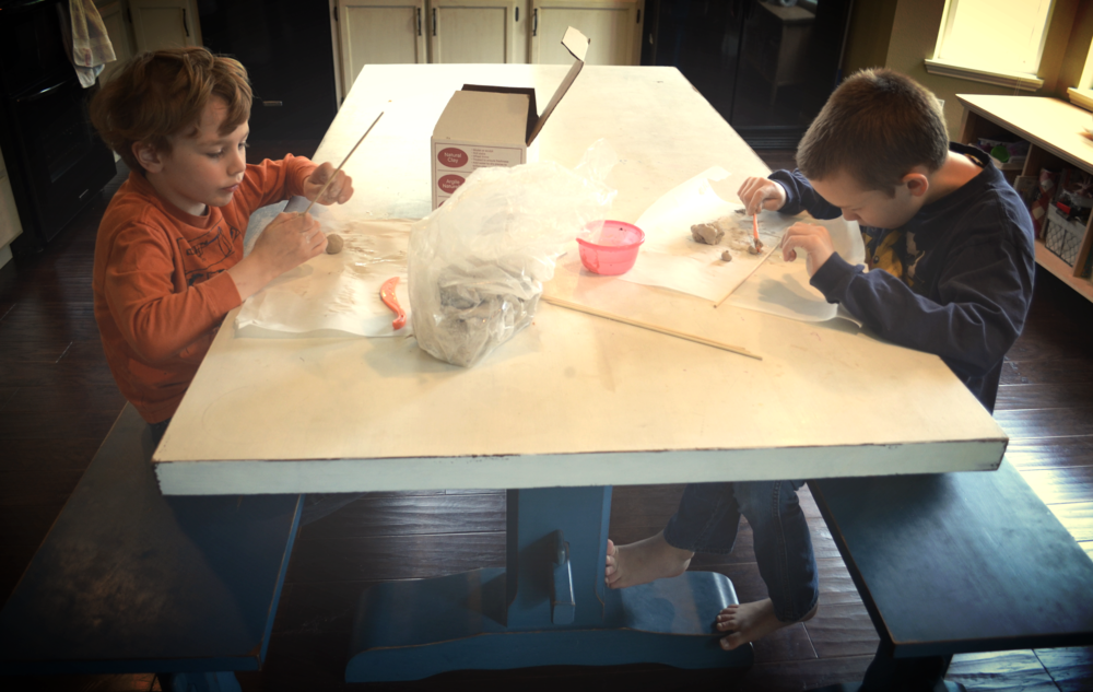 Working with clay at the kitchen table.